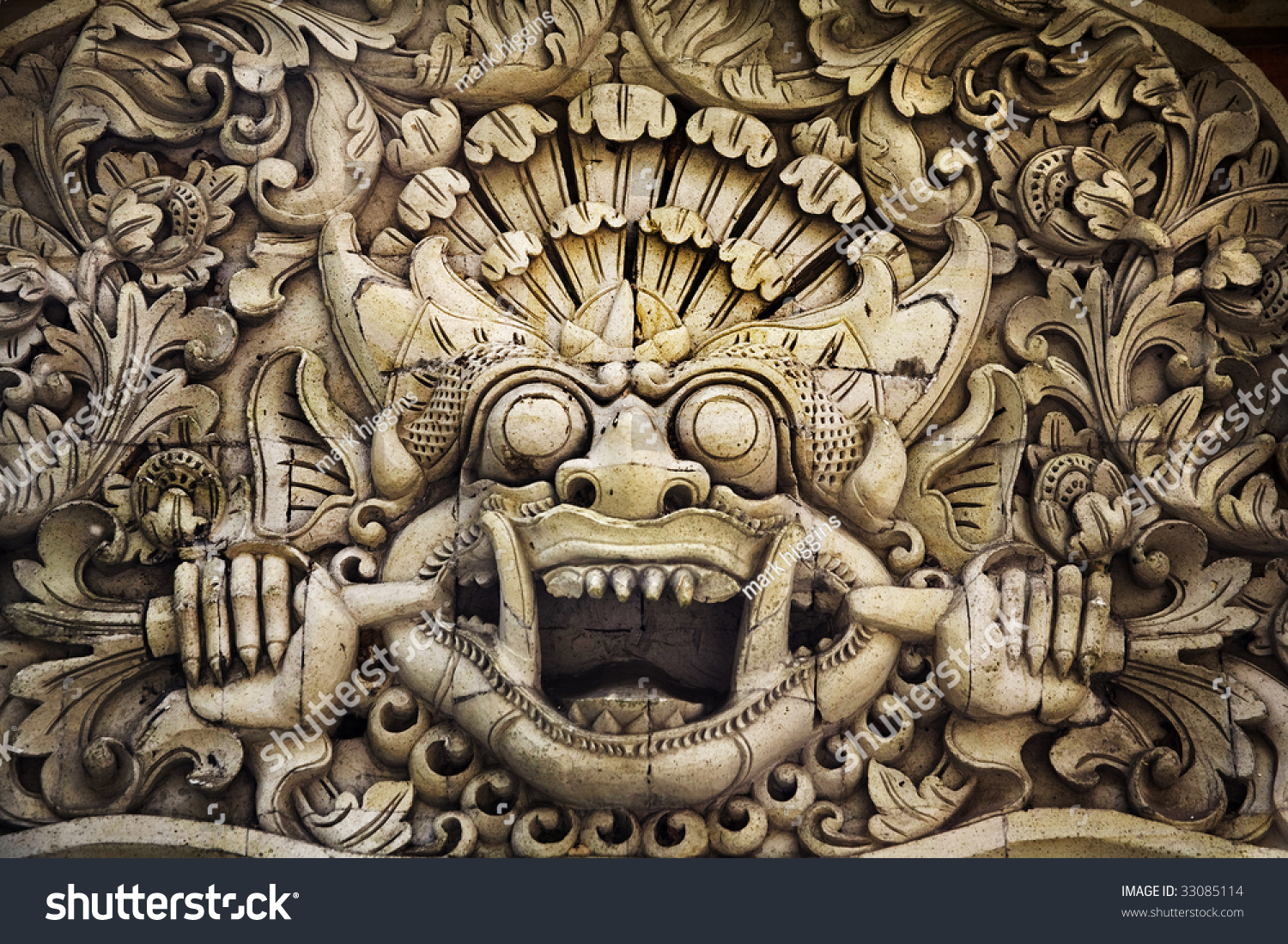 Ancient wall temple stone carvings bali traditional garuda