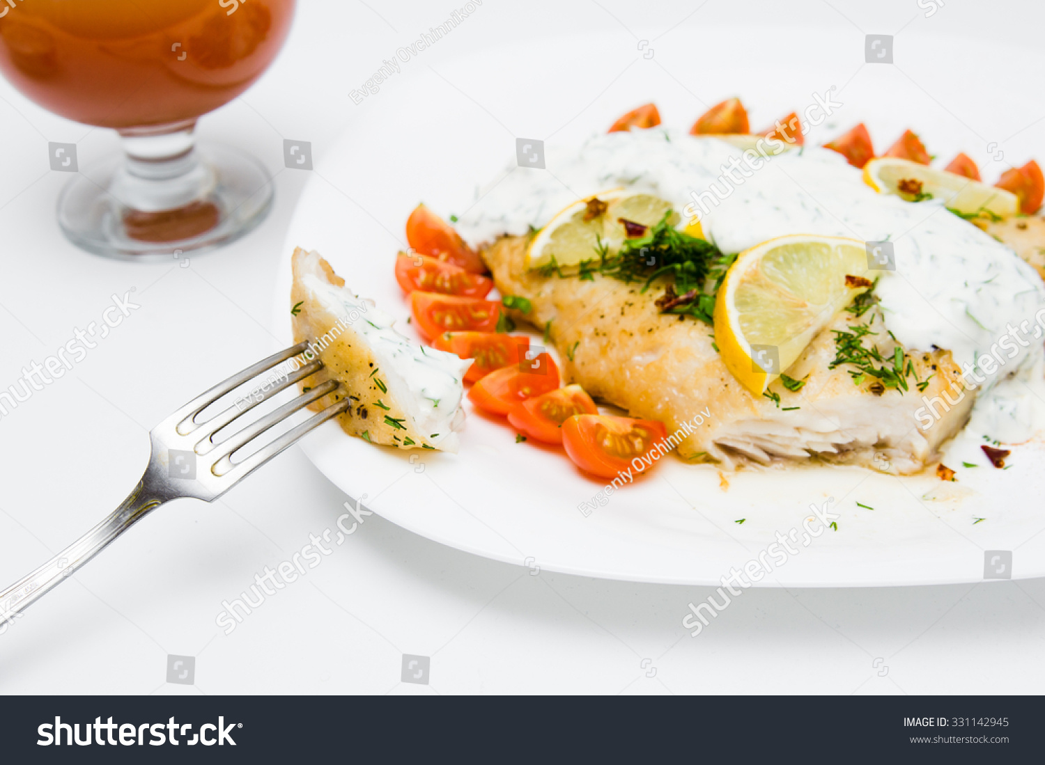 Grilled fish vegetables cream sauce on stock photo for Fish with vegetables