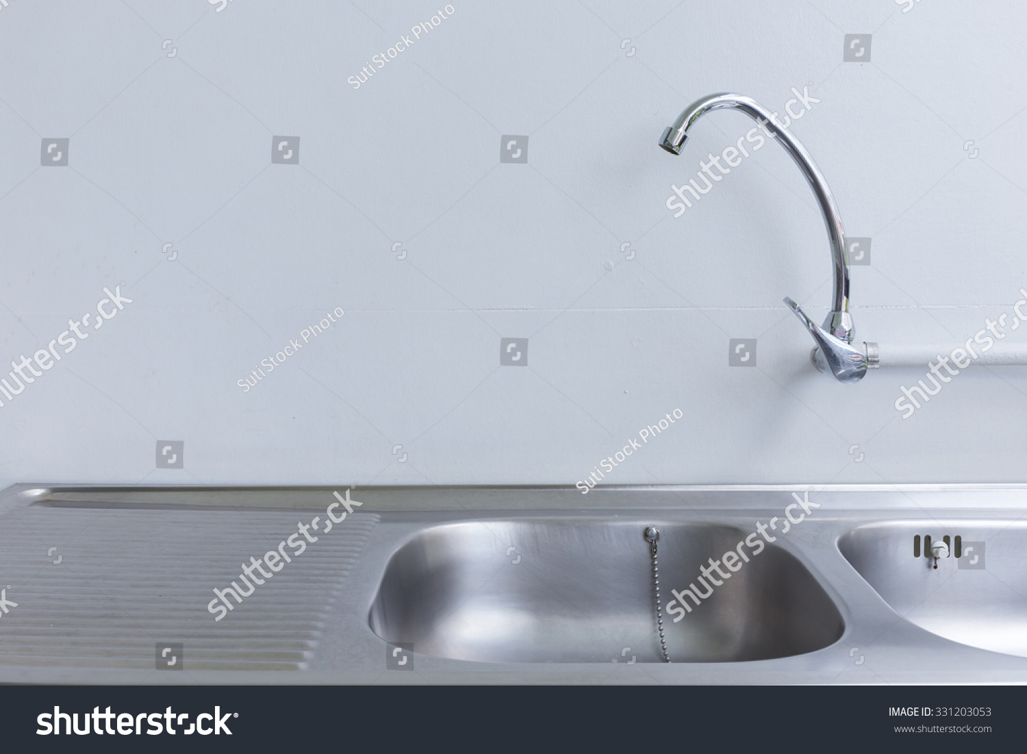 stainless steel sink and faucet in white kitchen room | EZ Canvas