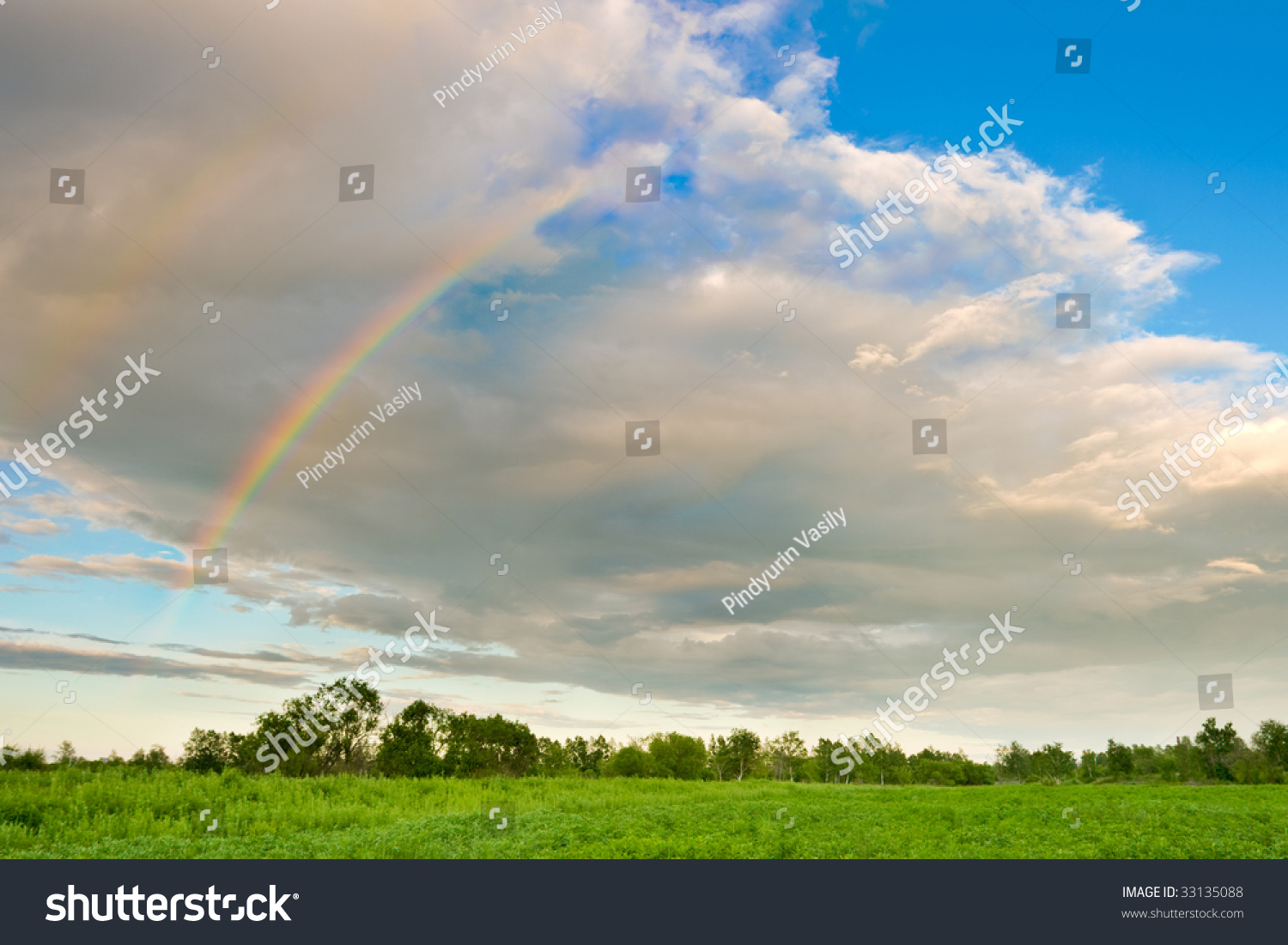 part of color rainbow over the green forest stock photo