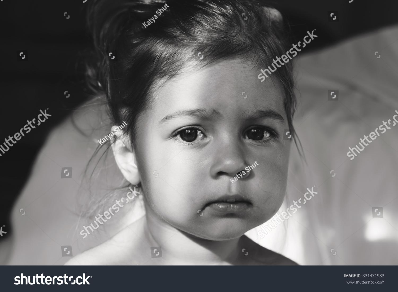Toned Portrait Of Cute Sad Baby Girl Thinking Stock Photo -9312