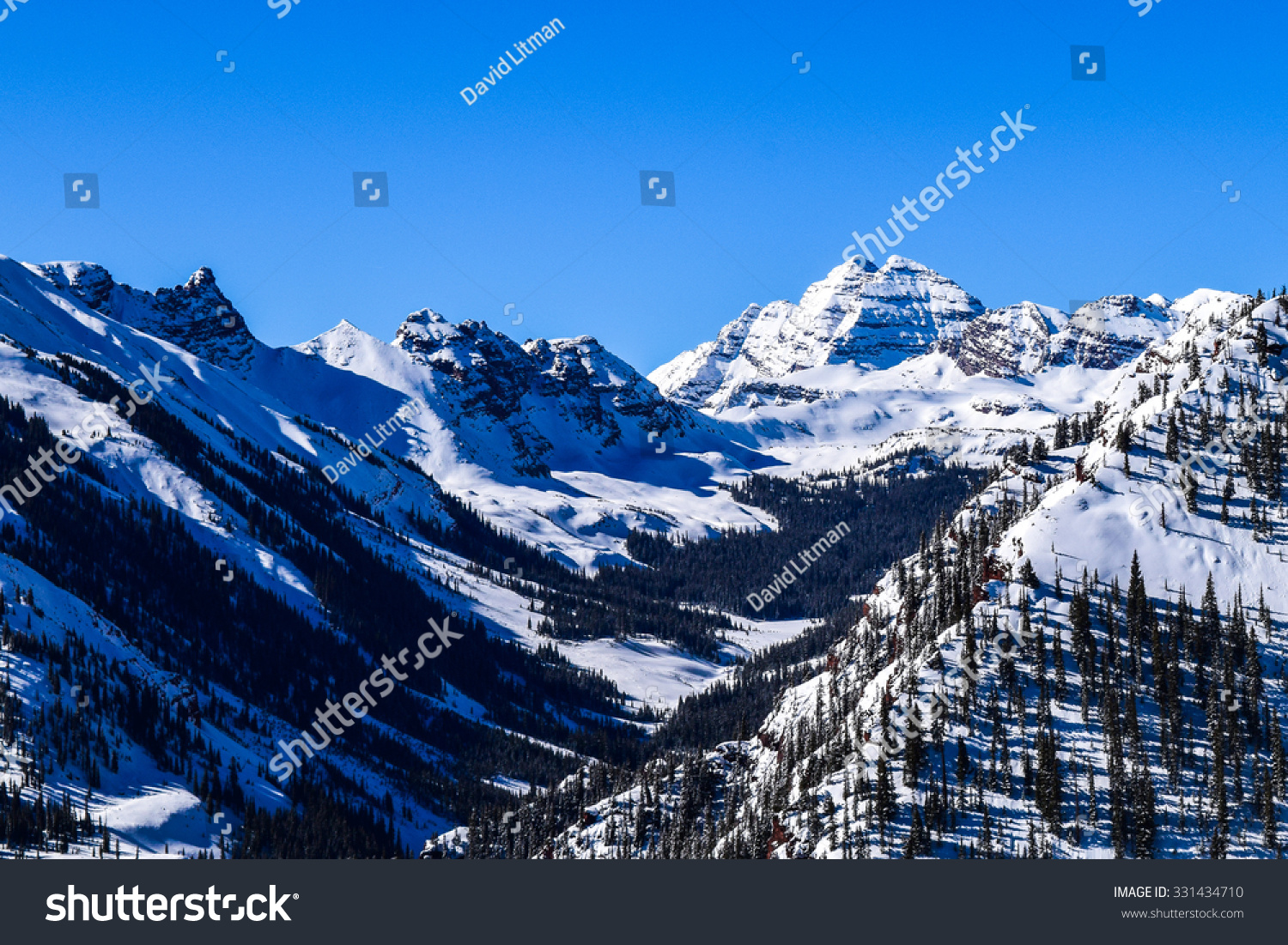 Rocky Mountains Maroon Bells.  The Rocky Mountains of Colorado, with the Maroon Bells Peak, as viewed from the top of the Aspen Snowmass ski resort on a clear winter day.