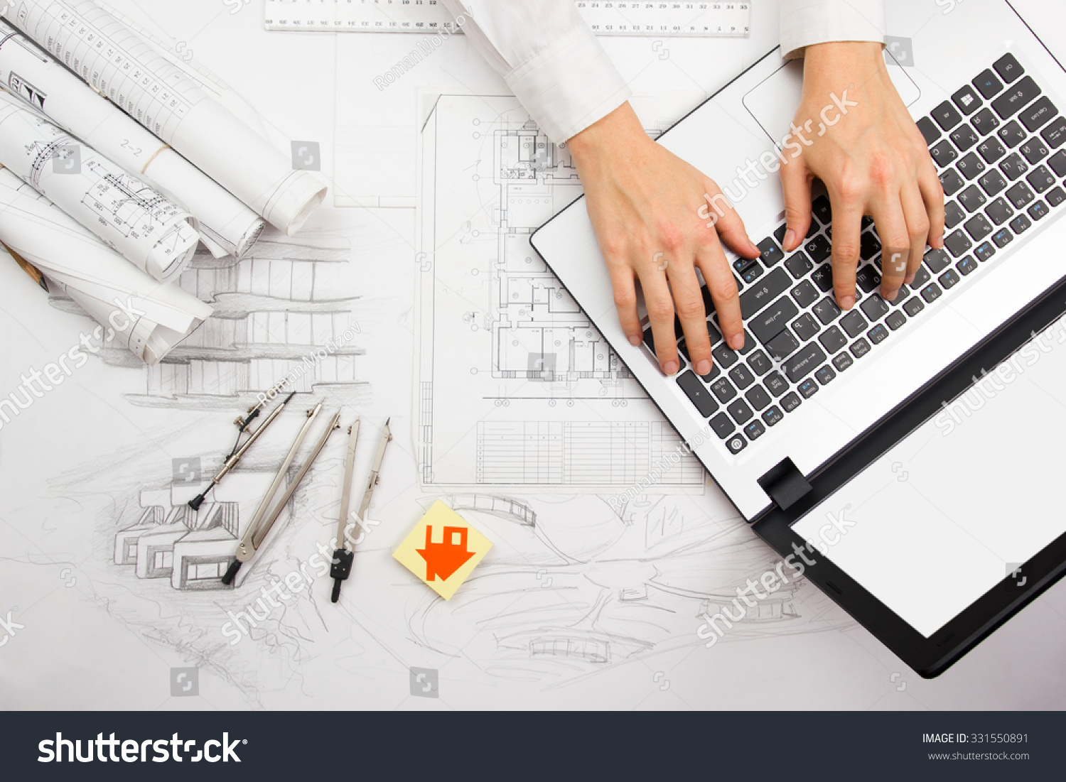 Architect working on blueprint architects workplace stock for Blueprint estimator
