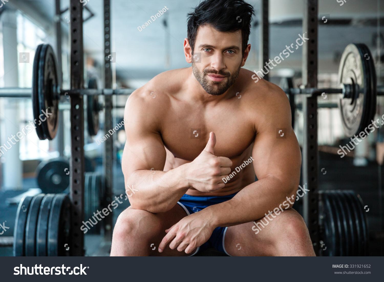 Portrait Handsome Male Bodybuilder Sitting On Stock Photo