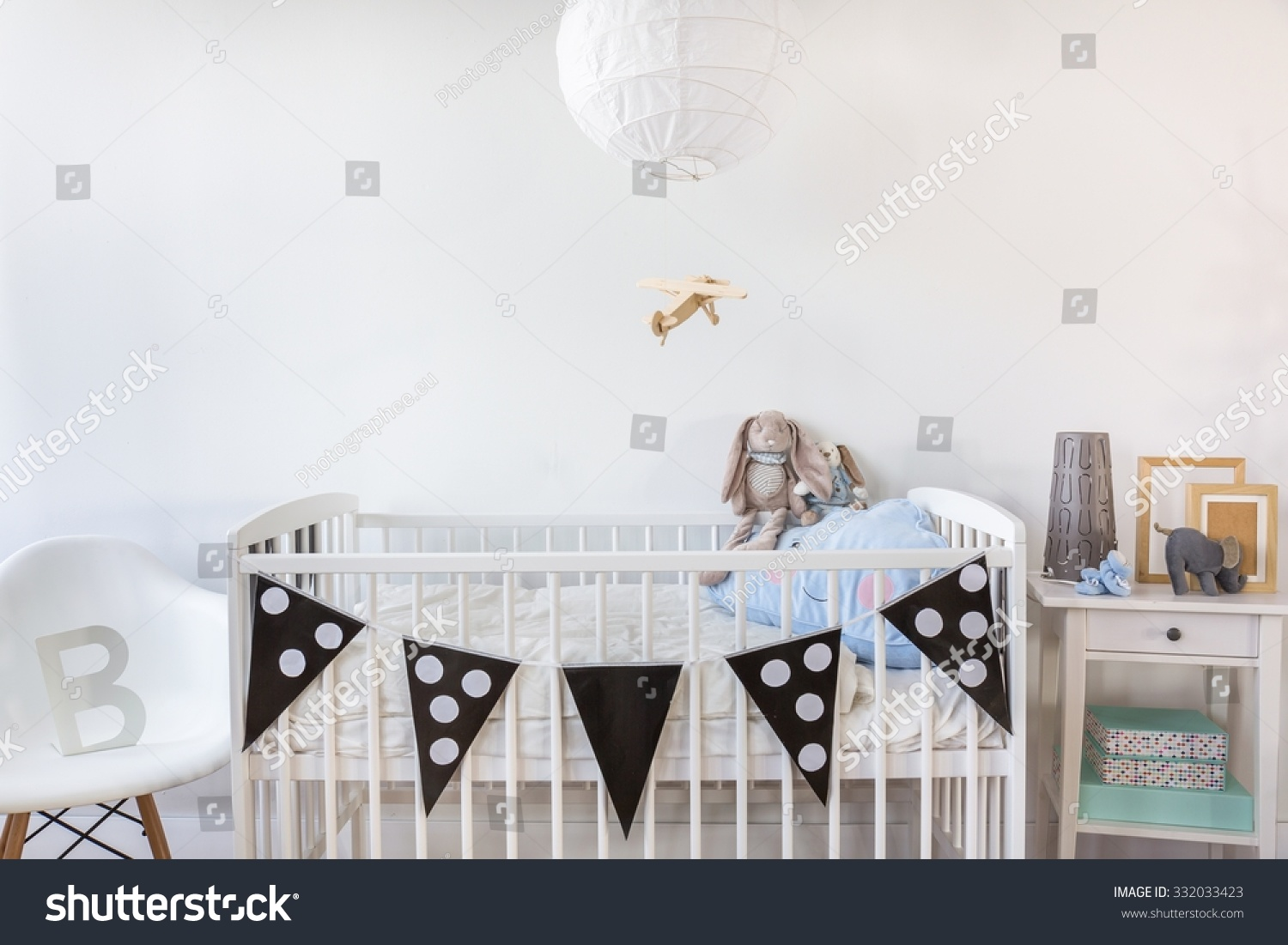 Image of white baby cot with decoration stock photo for Baby cot decoration images
