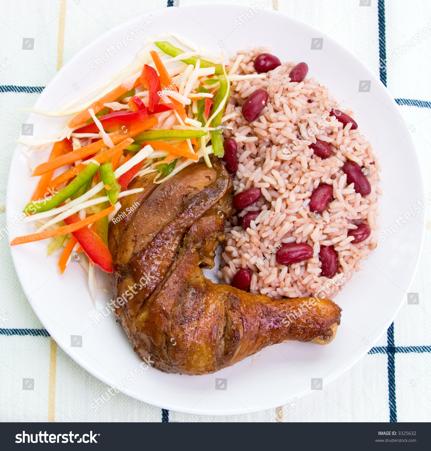 Caribbean style jerk chicken served with rice mixed with red kidney ...