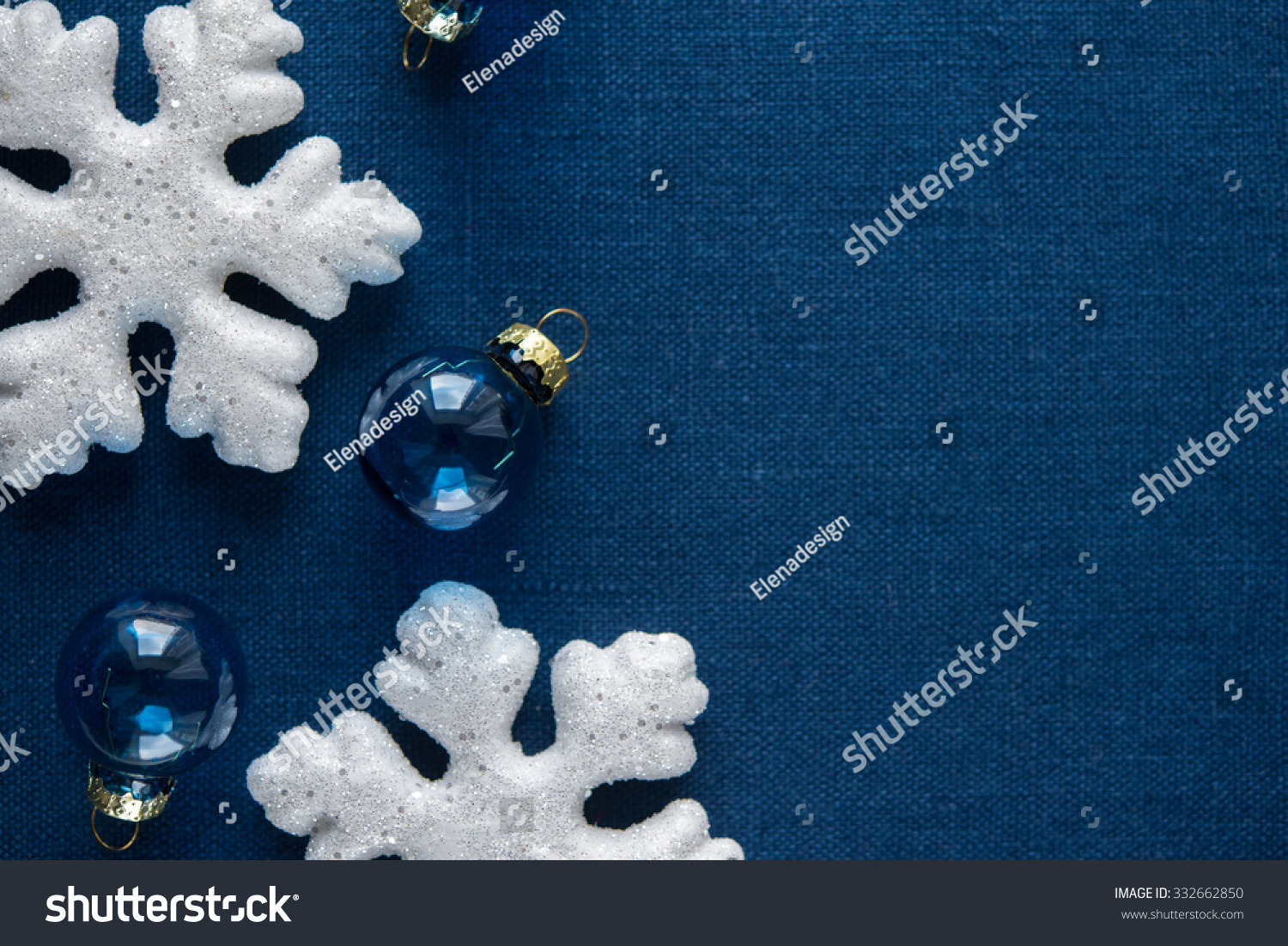 White And Blue Xmas Ornaments On Canvas Background Merry