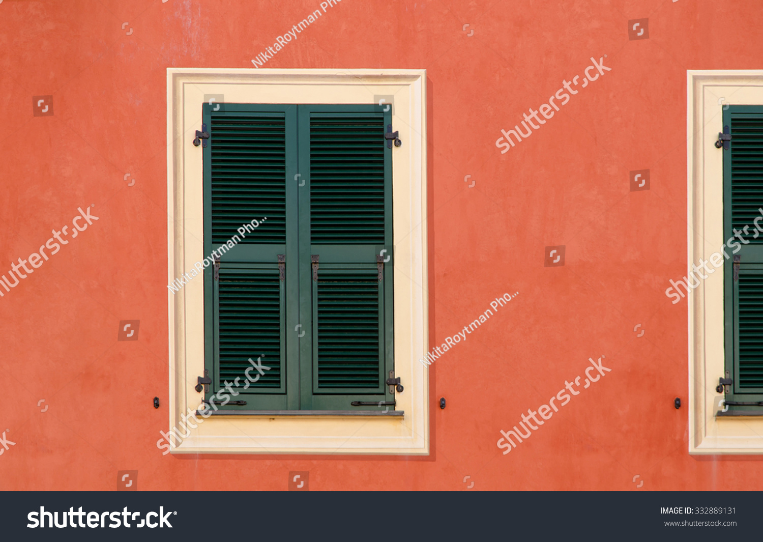 Wood Shutters Closed : Decorative wooden window shutters closed on the exterior