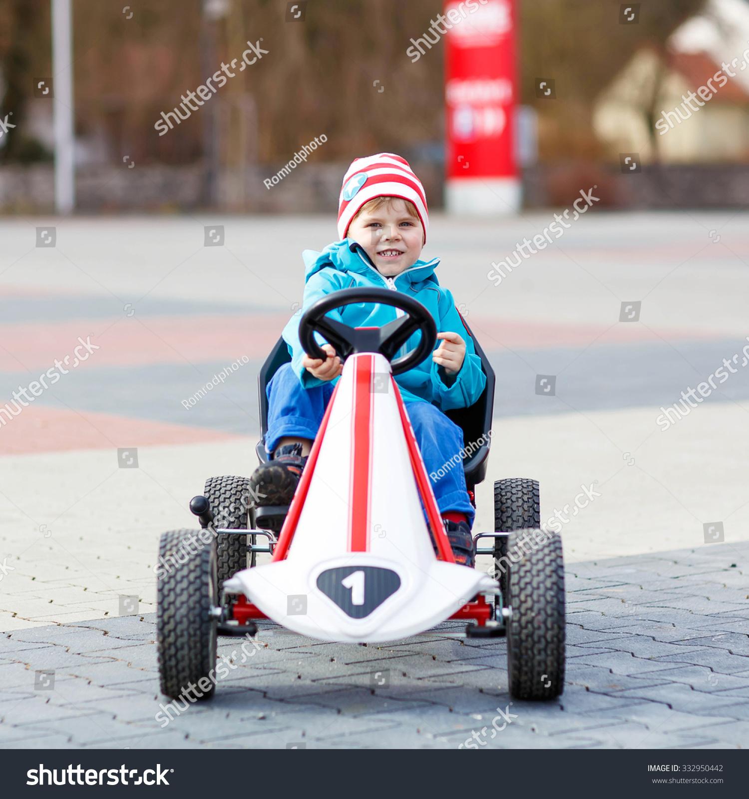 funny little kid boy having fun stock photo 332950442 shutterstock
