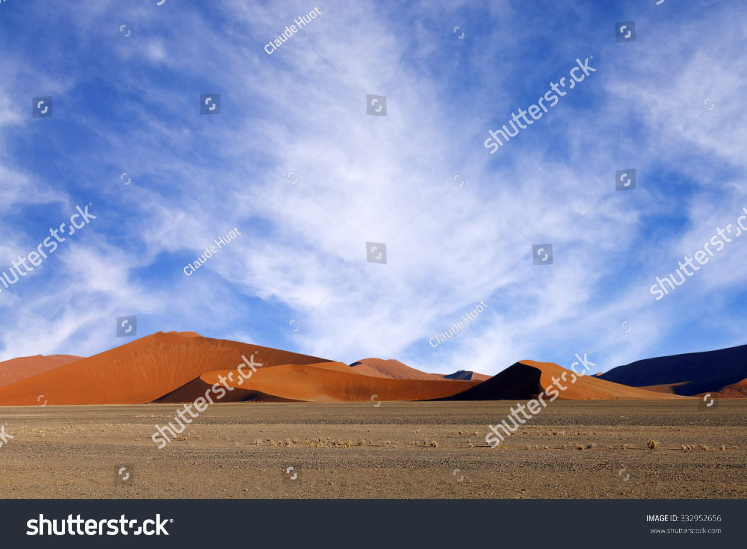 Red sand dunes before sunset, casting nice shadows in Sossusvlei in the Namib-Naukluft National Park of Namibia