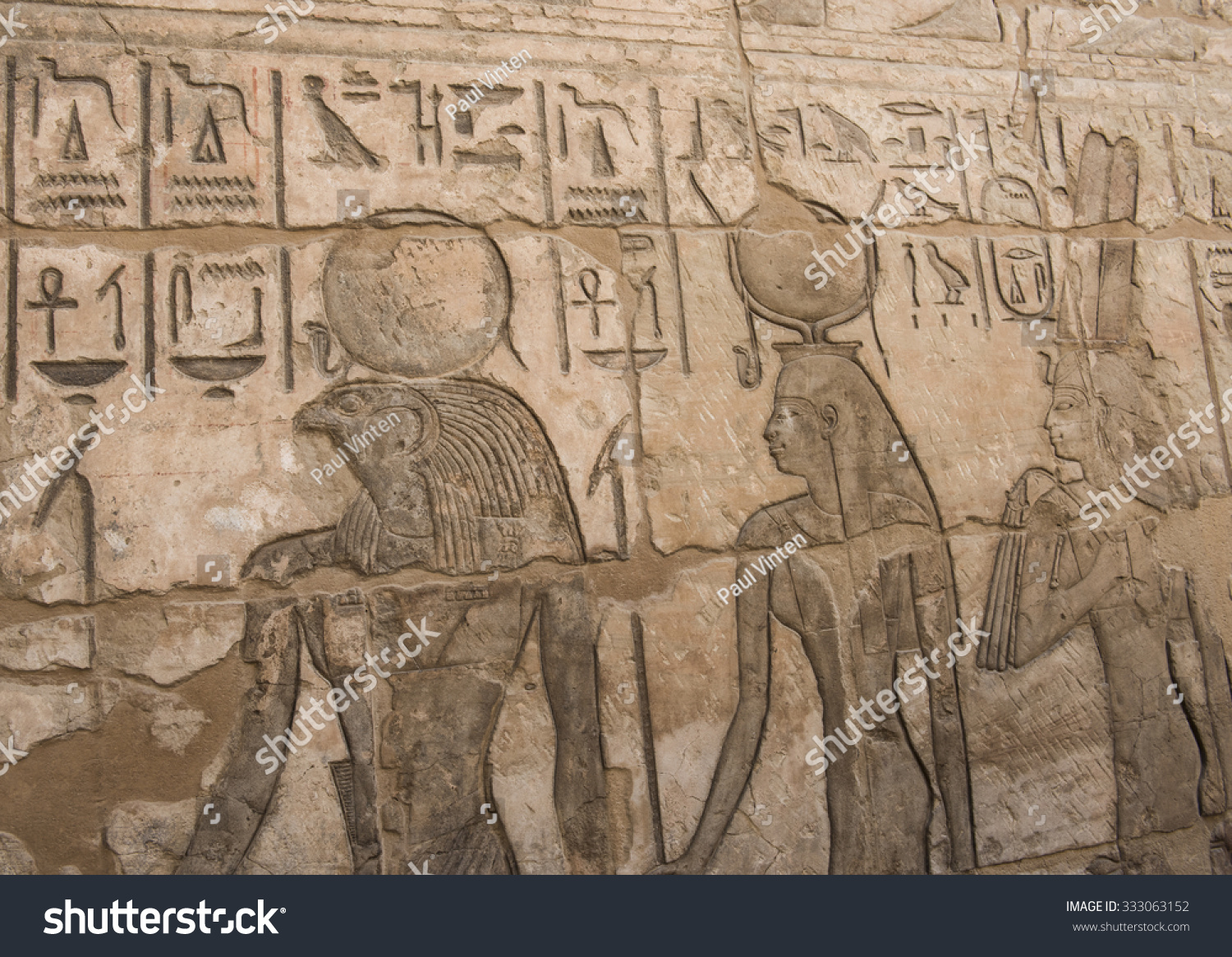 Ancient egyptian hieroglyphic carvings on a temple wall at