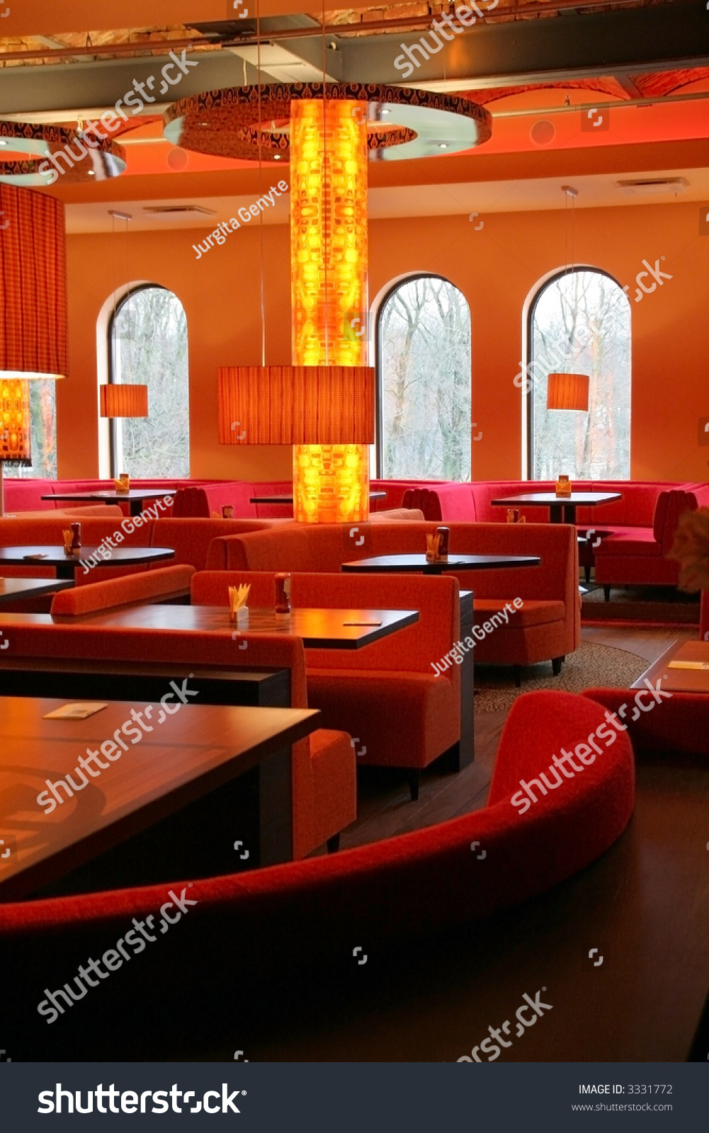 Red restaurant interior with column in the center stock