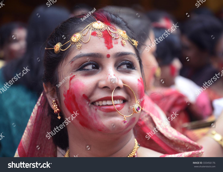 Bengali house wife smile and enjoy sindur vermilion khela for Bangla house photo