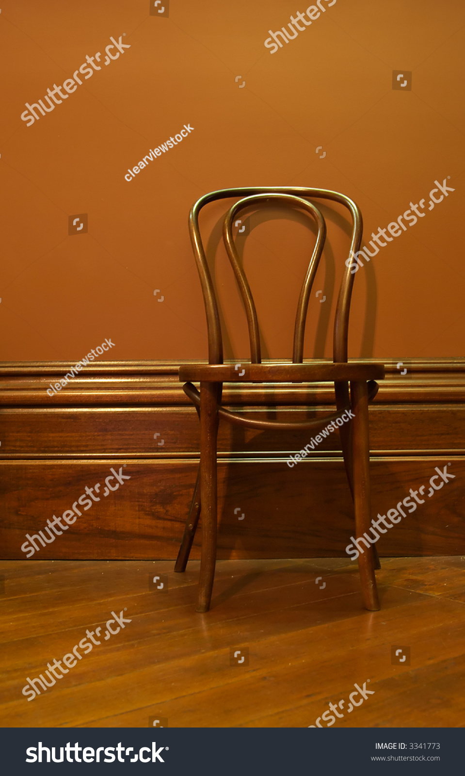 a brown wooden chair against the wall in a brown waiting room stock photo 3341773 shutterstock. Black Bedroom Furniture Sets. Home Design Ideas