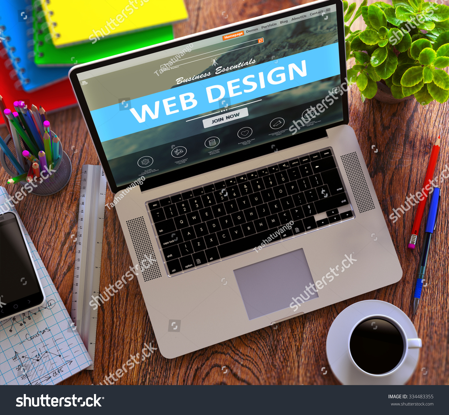 web design concept modern laptop and different office supply on wooden desktop background