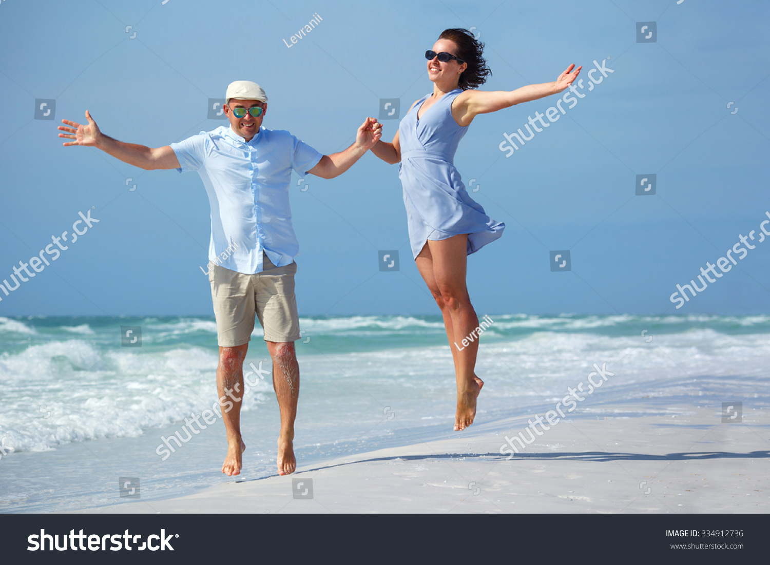 Young couple having fun tropical beach stock photo for Tropical vacations for couples