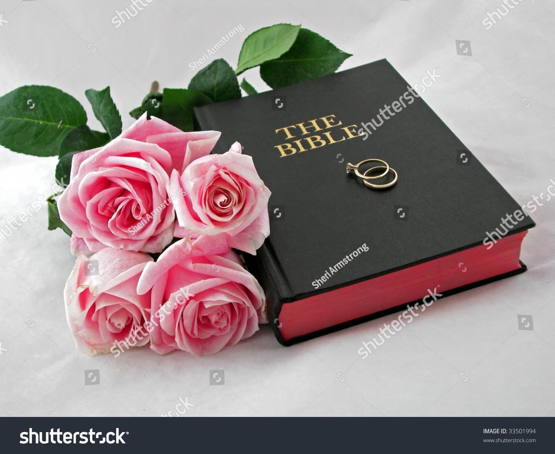 Pink Roses Wedding Rings On Bible Stock Photo & Image (Royalty-Free ...