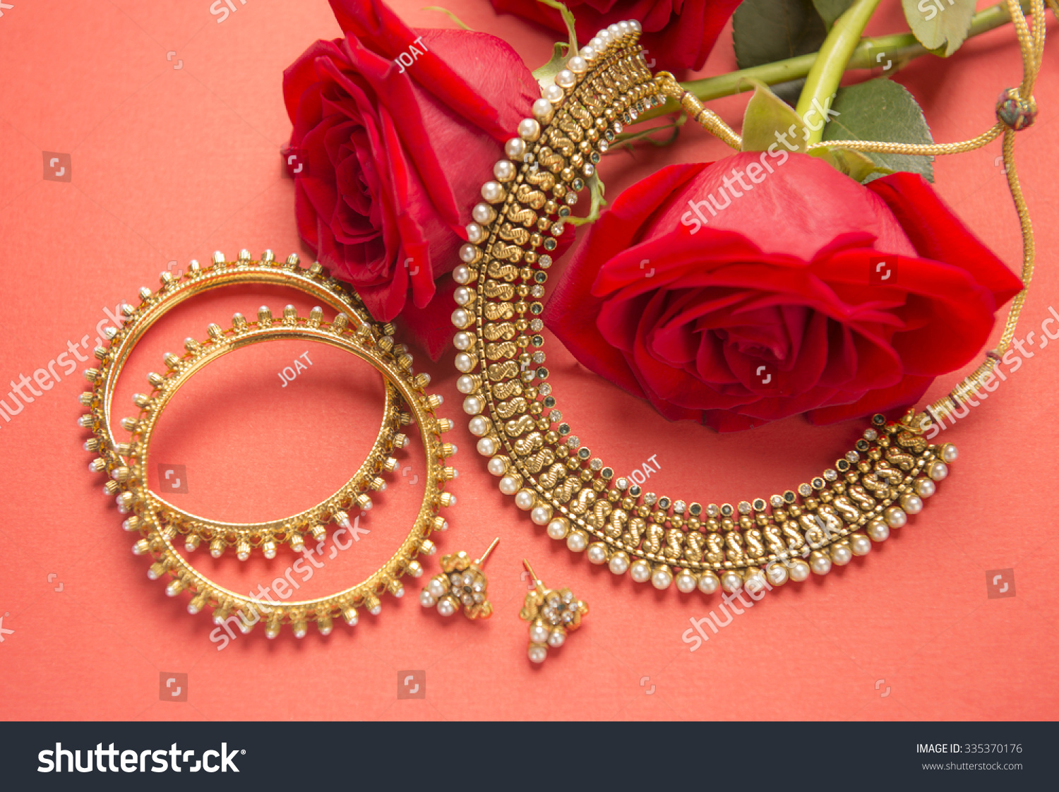 Traditional Indian Gold Jewelry Red Roses Stock Photo 335370176 ...