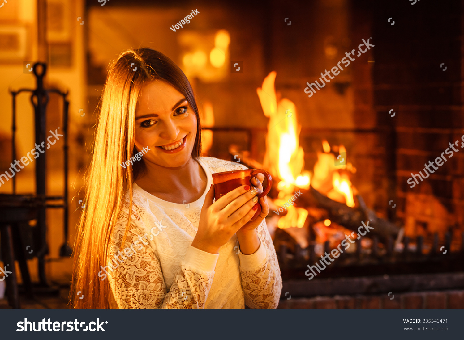 woman drinking cup coffee relaxing fireplace stock photo 335546471