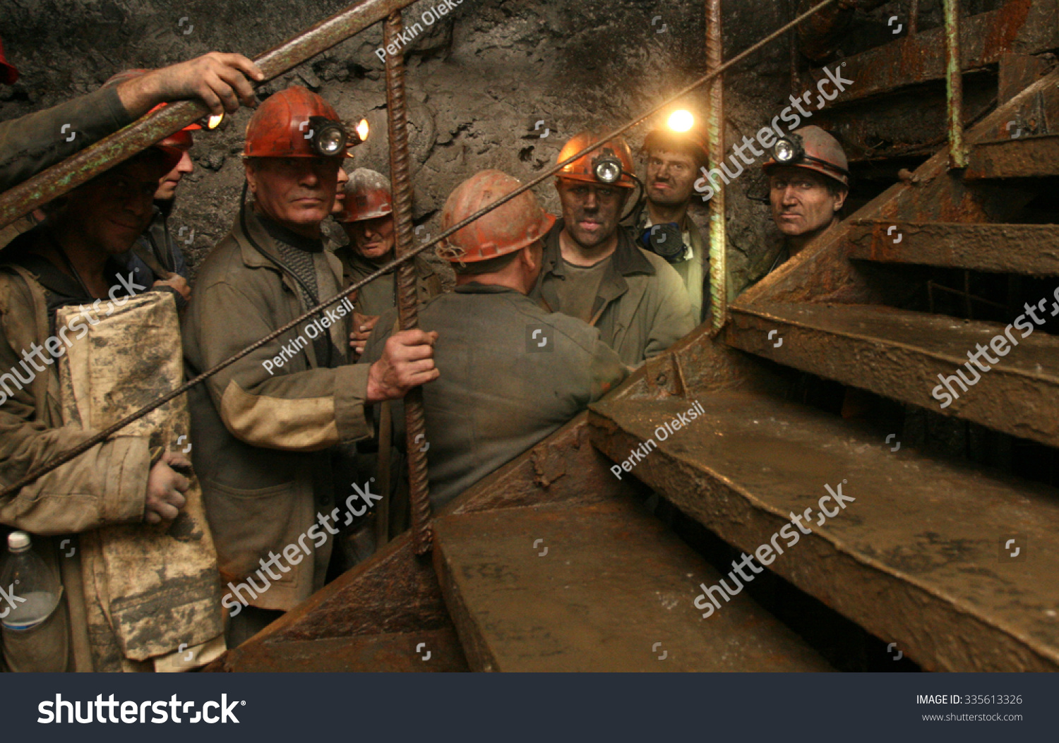 DONETSK UKRAINE September 26 2007 Coal miners at Abakumova mine wait to lower into the breast by an elevator for shift change