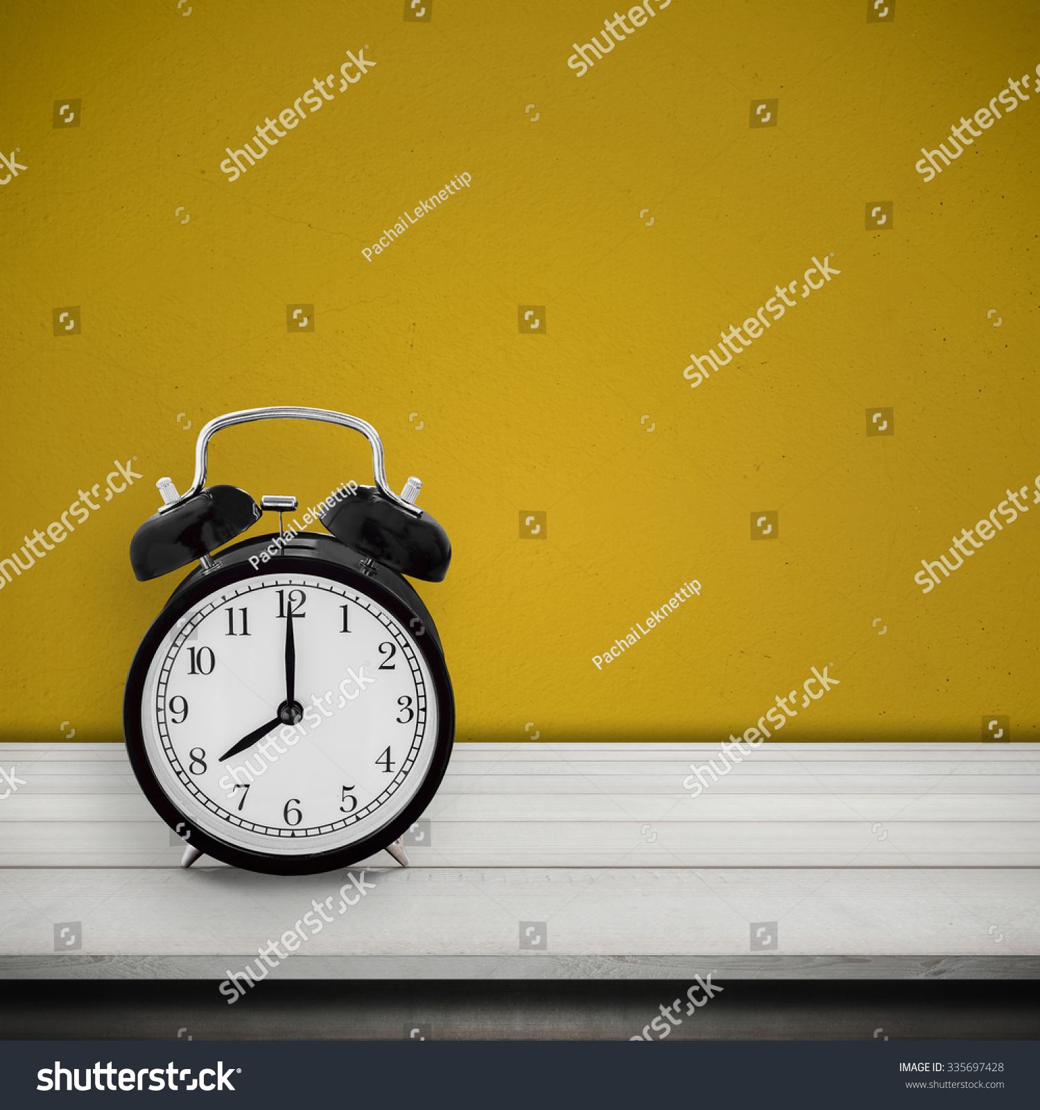 Vintage alarm clock on wood table stock photo 335697428 shutterstock vintage alarm clock on wood table desk over cement wall painted yellow color background alarm amipublicfo Image collections