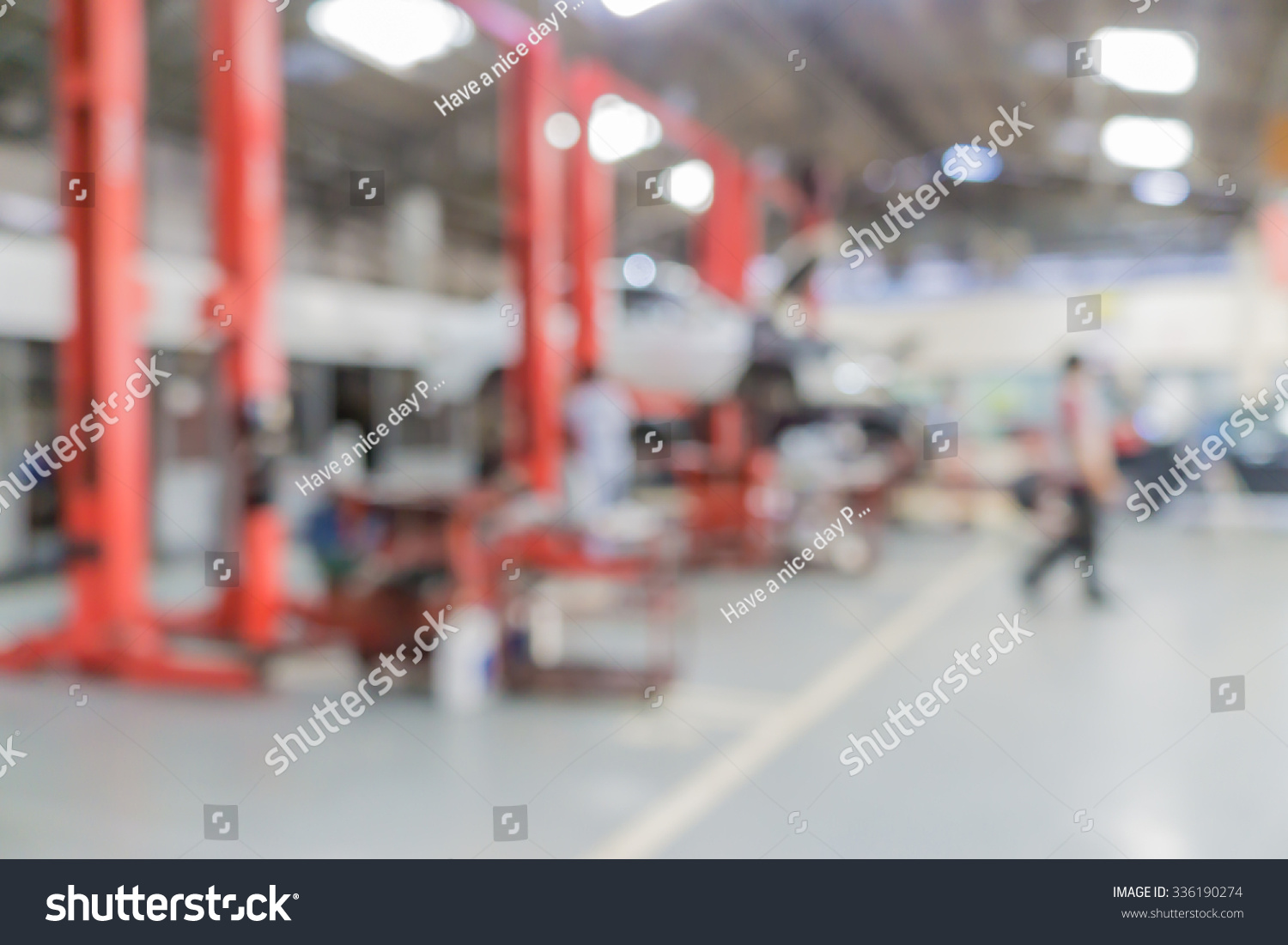 blurred of car technician repairing the car in garage background interior of a car repair. Black Bedroom Furniture Sets. Home Design Ideas