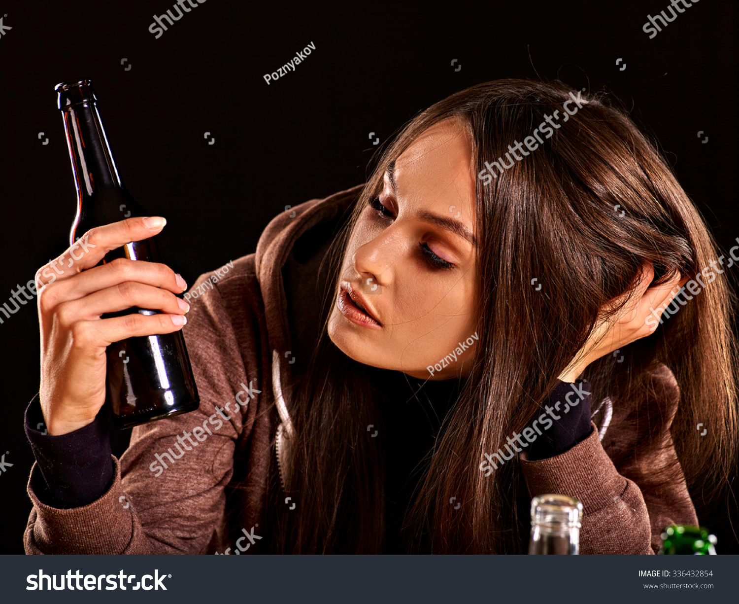 stock-photo-drunk-girl-looking-at-bottle