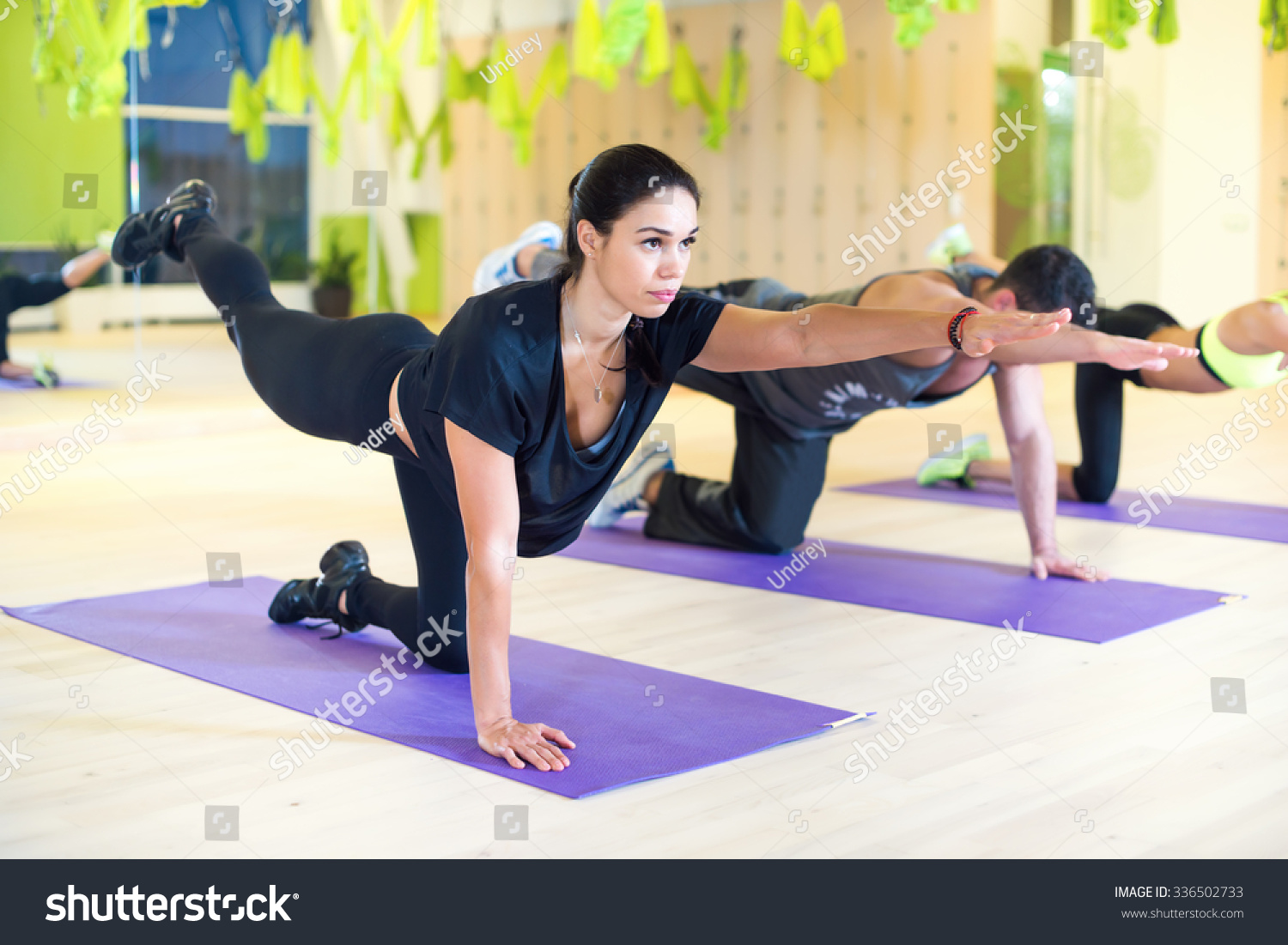 Group women stretching traning exercising in gym practicing yoga pilates