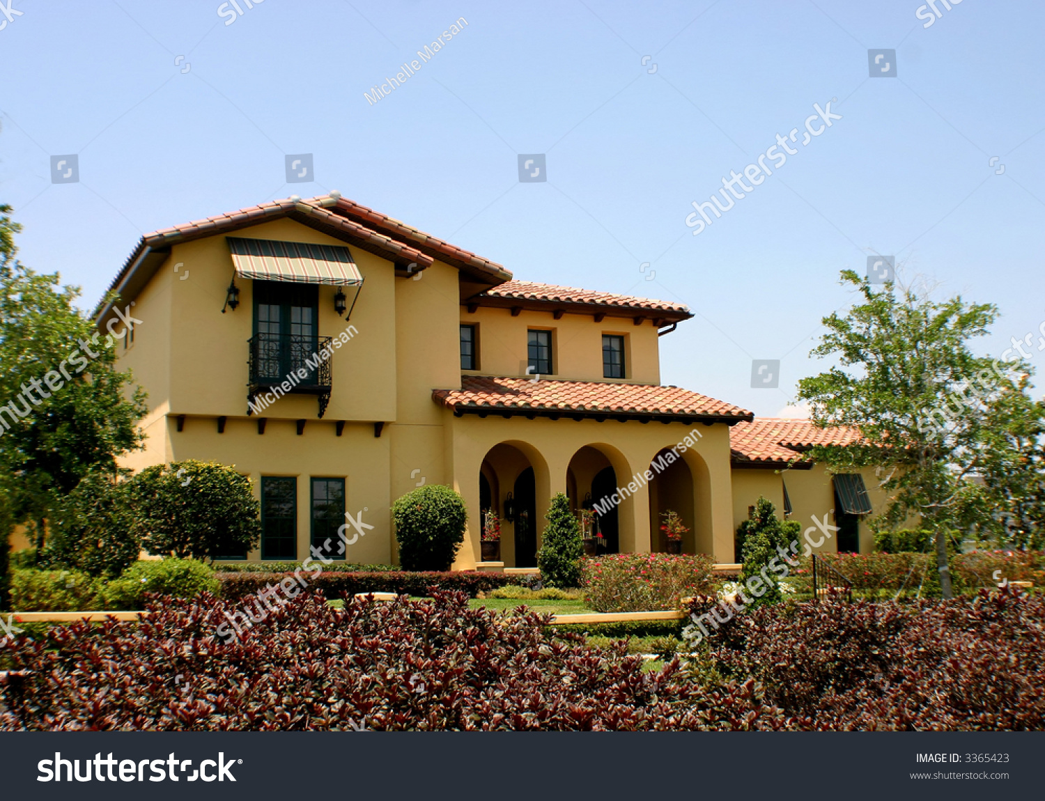 Spanish style home stock photo 3365423 shutterstock for Spanish style shutters