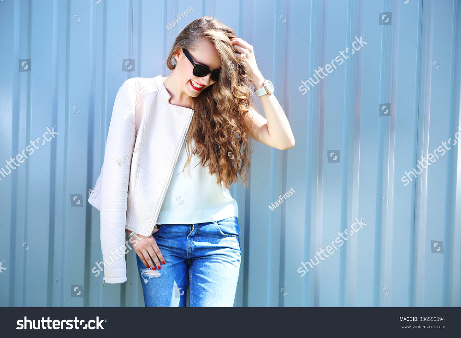 Hair Style Jeans: Fashion Model Long Curly Hair Wearing Stock Photo
