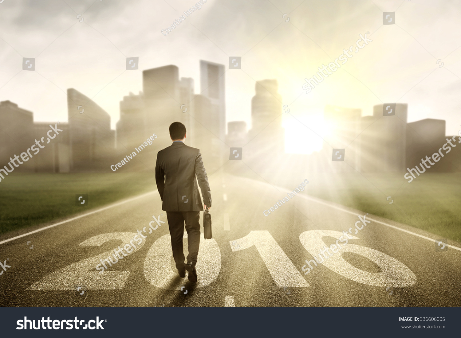 Image of male entrepreneur walking on the road with numbers 2016 while ...