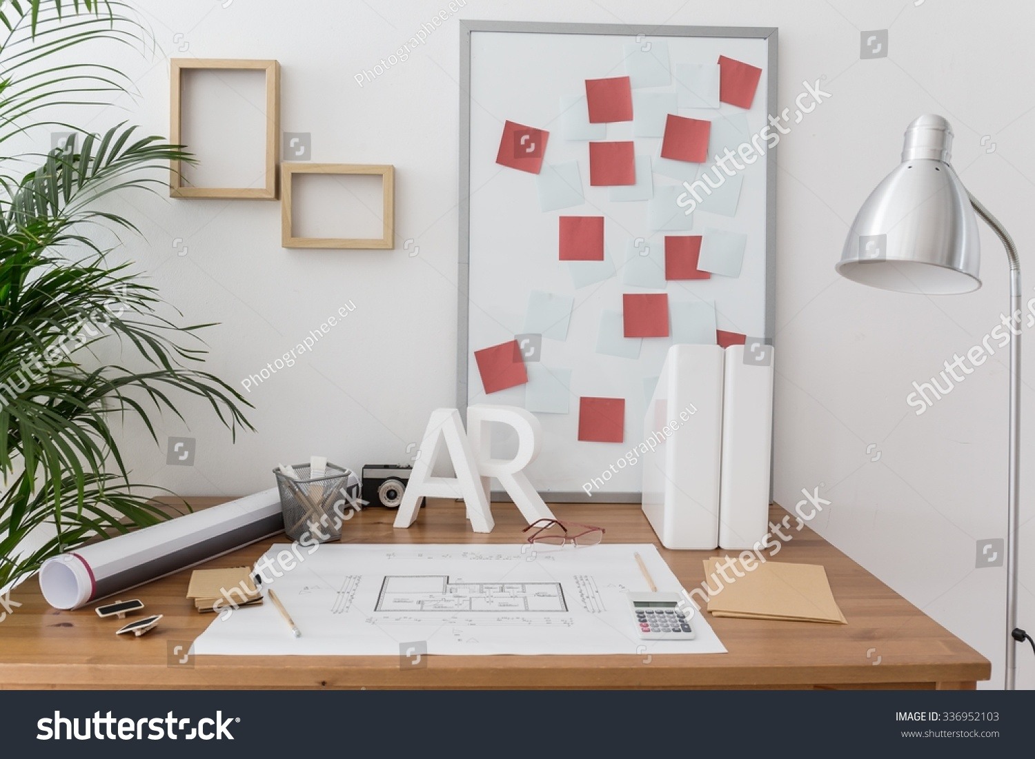 Office Of Professional Home Designer With Plans And Sketches