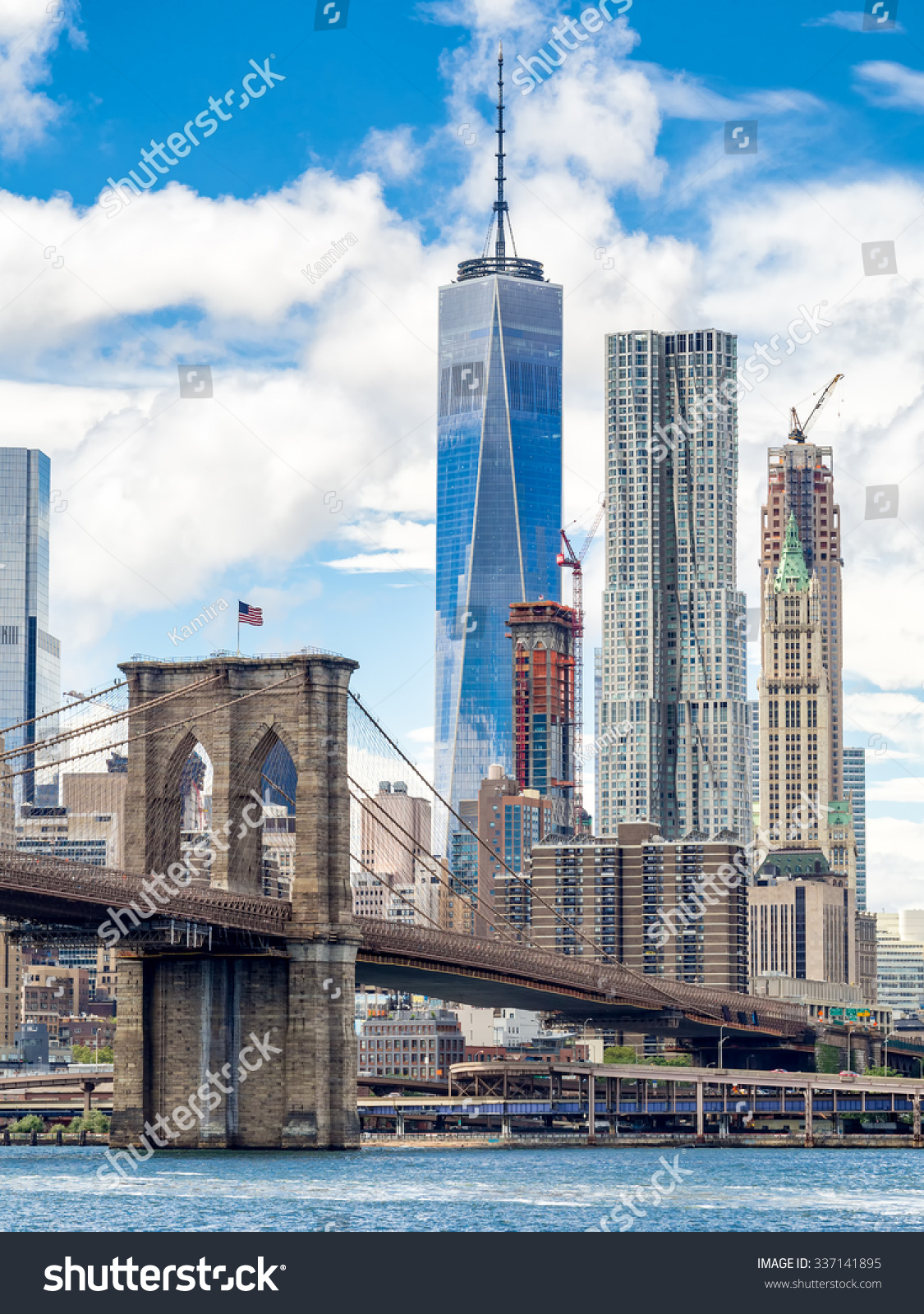 The Brooklyn Bridge And The Downtown Manhattan Skyline In