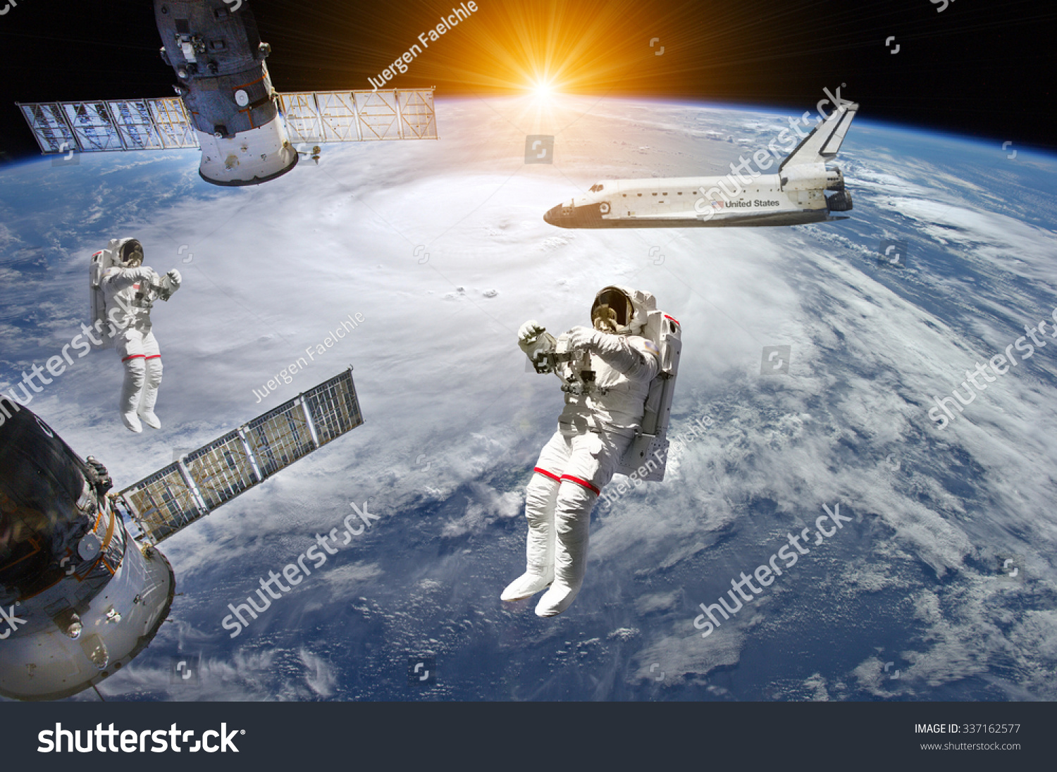 Astronauts space shuttle and station in outer space Elements of this image furnished by NASA