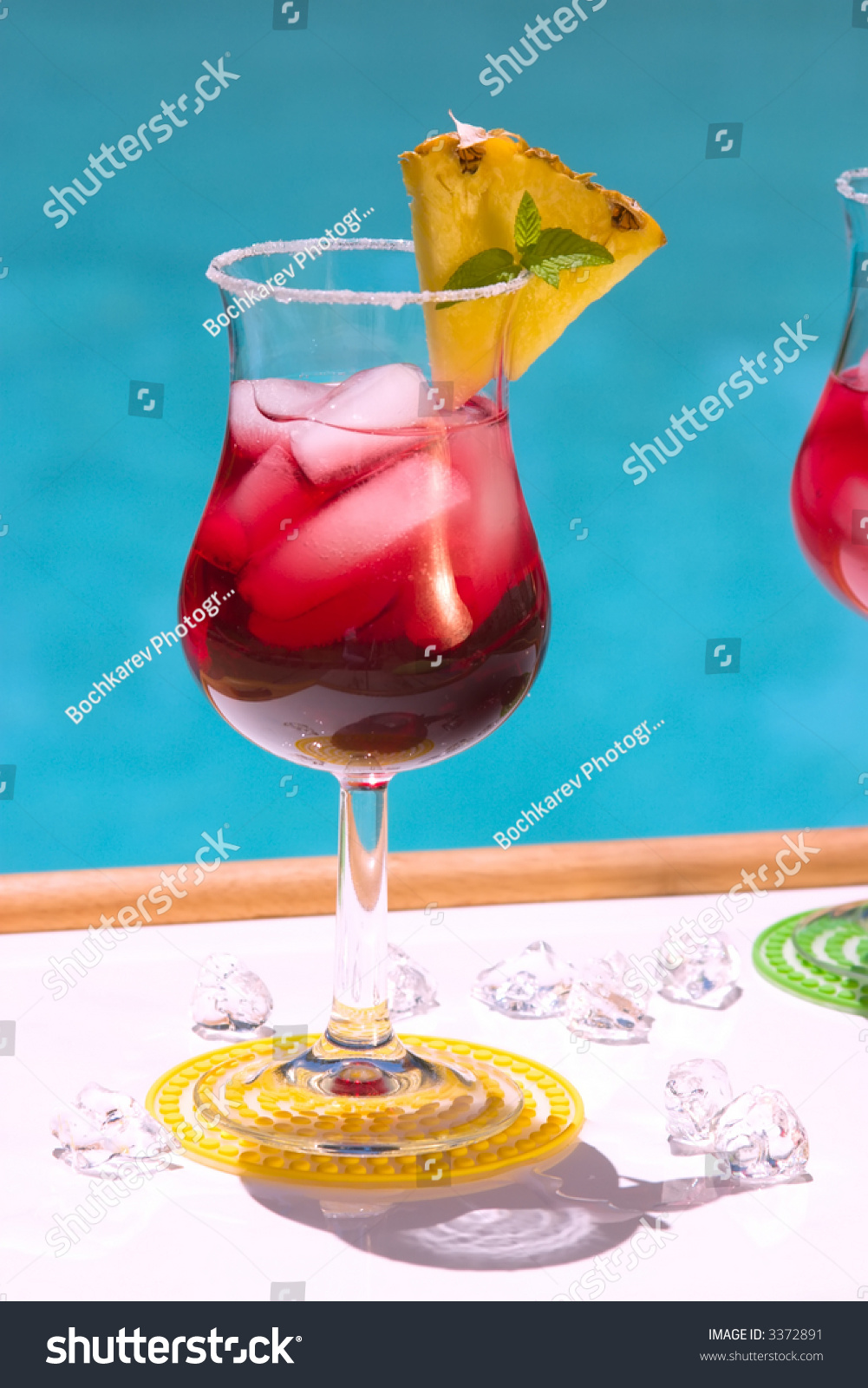 Glass of cranberry alcohol cocktail on swimming pool side - Get a swimming pool full of liquor ...