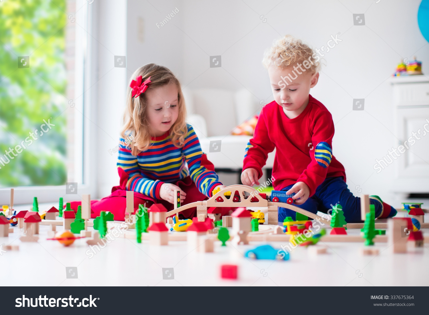Children Playing With Wooden Train Toddler Kid And Baby