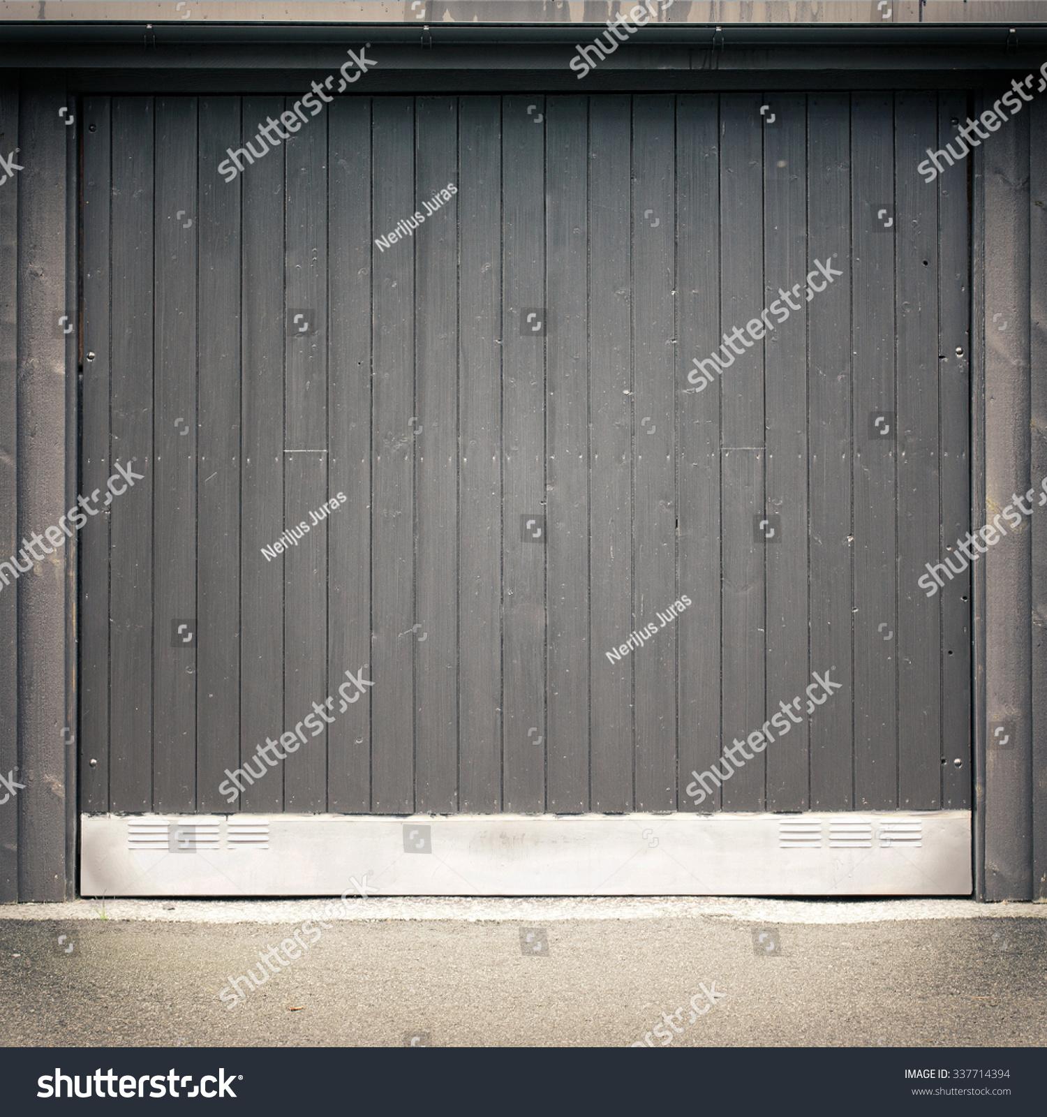 1600 #7E6B4D Dark Black Wooden Garage Door Asphalt Ground Stock Photo 337714394  wallpaper Dark Wood Garage Doors 36951500