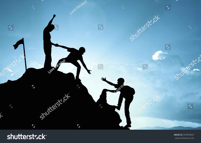 climbing helping team work success concept stock photo 337870697