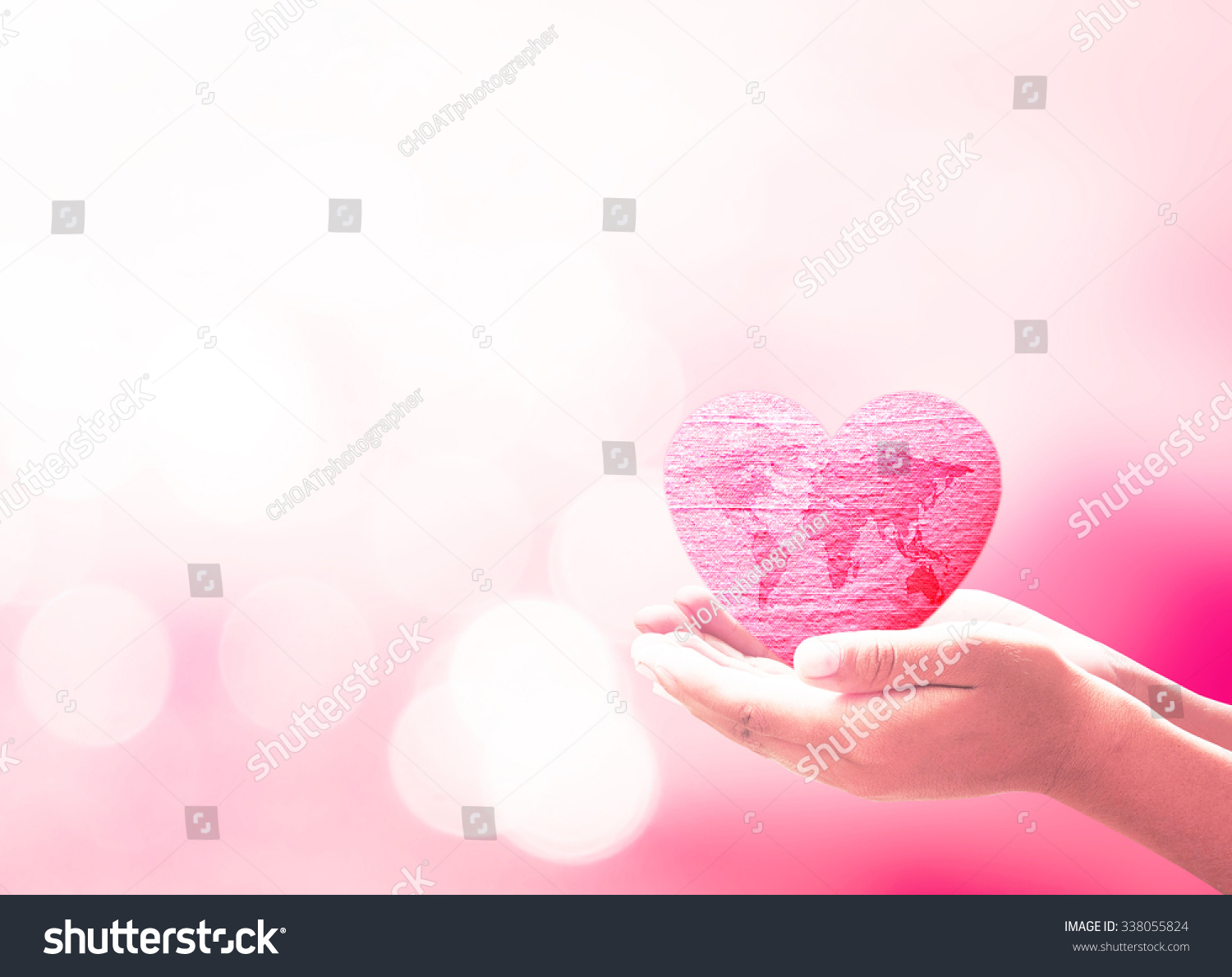 Royalty free world health day concept human hand 338055824 stock world health day concept human hand hold world map on red heart made of fabric gumiabroncs Gallery