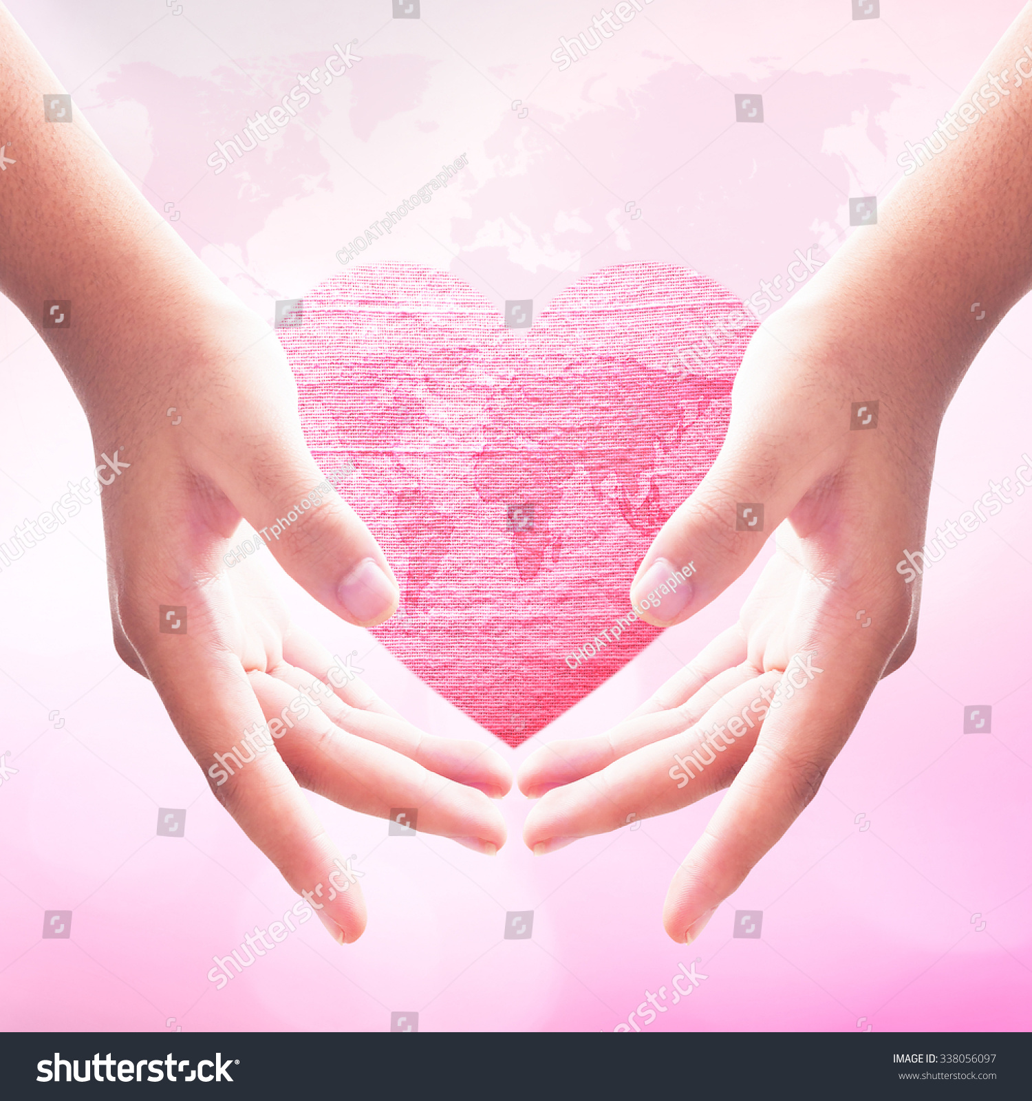Royalty free woman hand holding world map with big 338056097 stock woman hand holding world map with big red heart made of fabric texture on blur abstract gumiabroncs Gallery