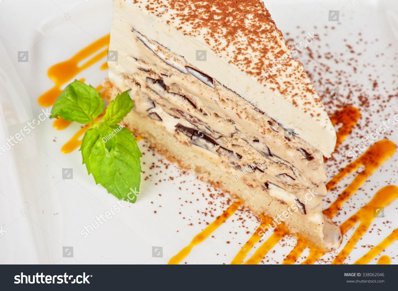 italian dessert cake from ice cream mascarpone cheese chocolate decorated with mango sauce. Black Bedroom Furniture Sets. Home Design Ideas