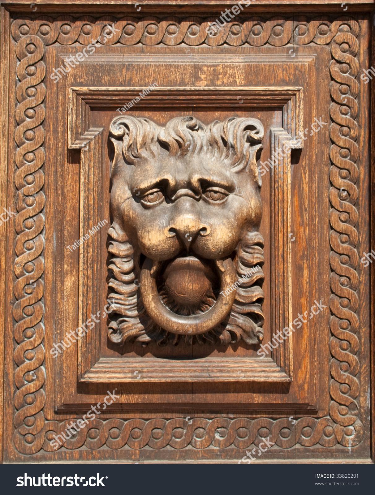 Fragment of woodcarving door in prague stock photo for Door z prague