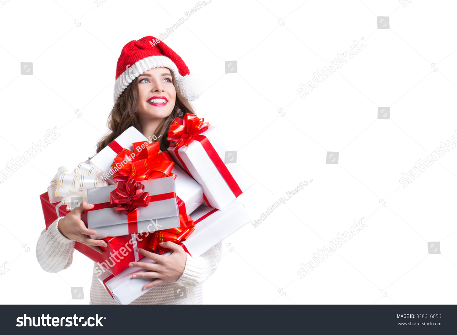 Beautiful woman in santa hat and gifts Christmas and New Year 2016