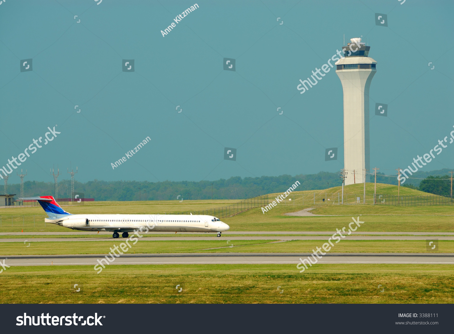 Airplane Landing In Front Of The Control Tower