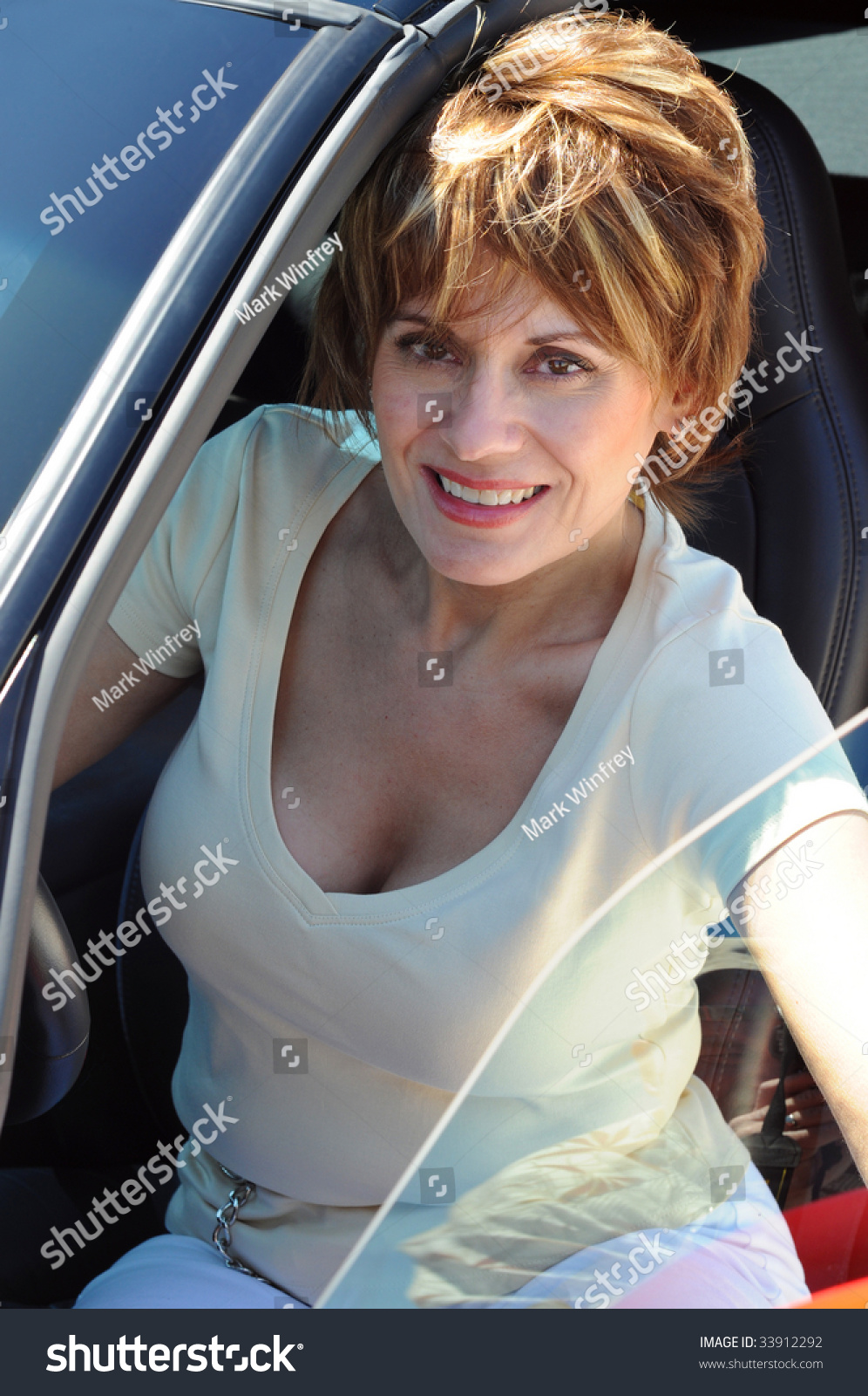 Attractive Woman in her Sports Car