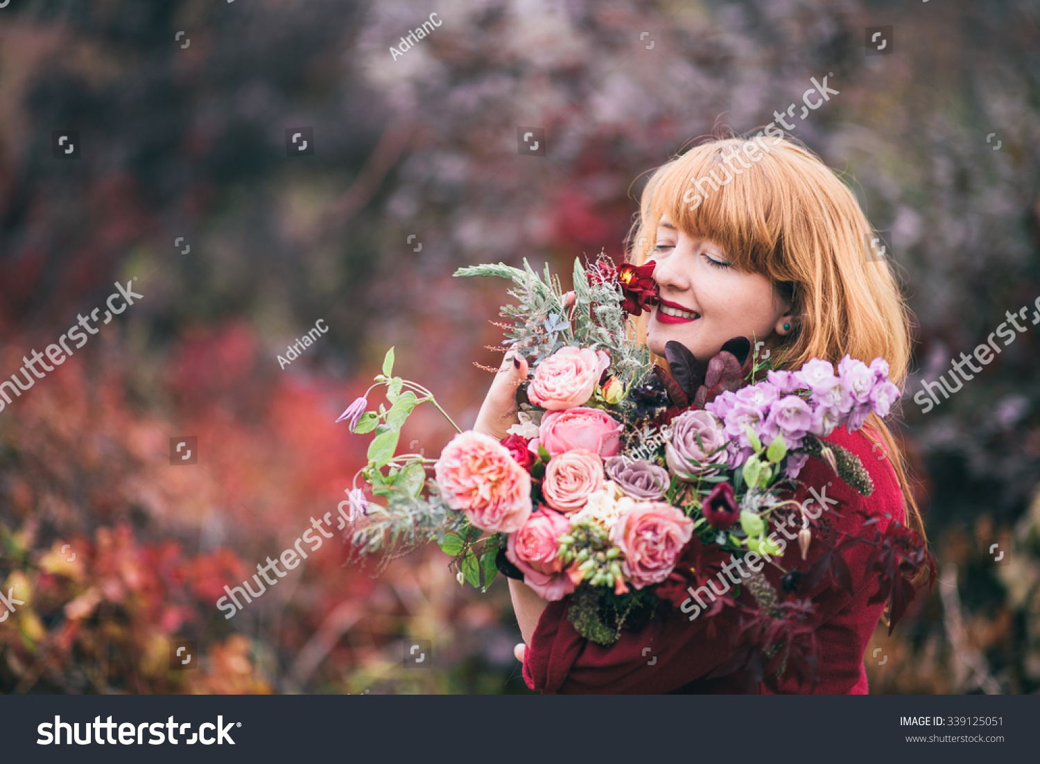 Girl holding colorful autumn bouquet woman stock photo royalty free girl holding colorful autumn bouquet woman holding beautiful fall flowers izmirmasajfo