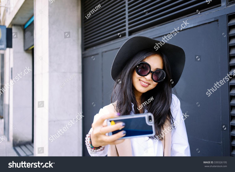 Young Asian Girl Taking Fun Selfie Stock Photo 339326195 - Shutterstock-7174