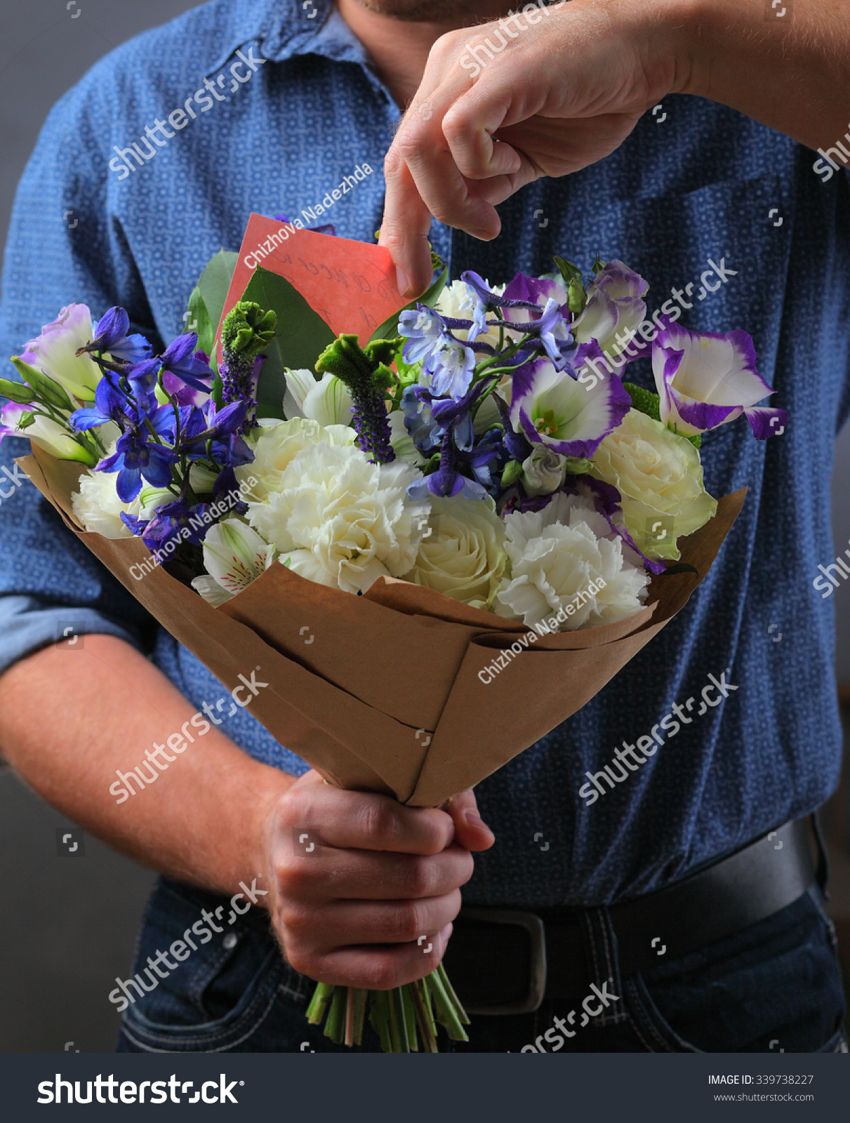 Man flowers love notes stock photo 339738227 shutterstock man with flowers and love notes izmirmasajfo Image collections