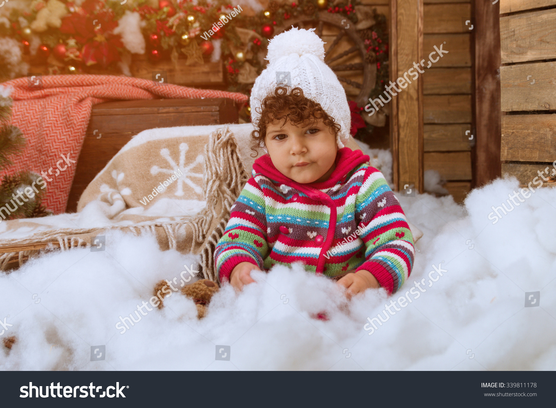 Little Girl Under Christmas Tree Wooden Stock Photo