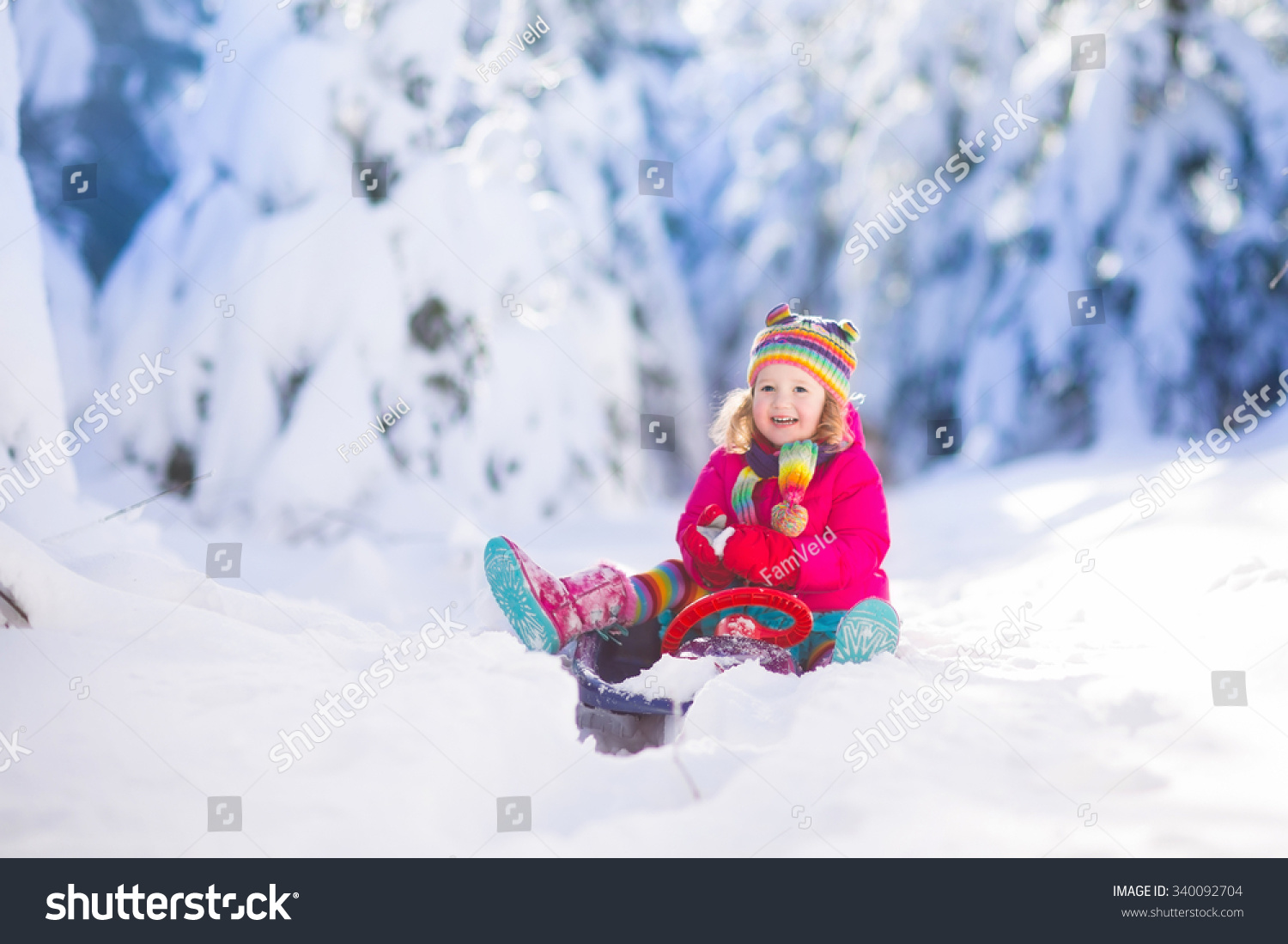 Little girl enjoying sleigh ride child stock photo for Vacation in the snow